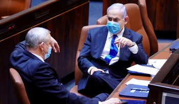 Benjamin Netanyahu (R) and Benny Gantz during a swearing in ceremony of the new government in Jerusalem, May 17, 2020.