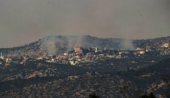 Smoke rises above a Shaba Farms village in southern Lebanon following an exchange of fire between Israel and Hezbollah, July 27, 2020.