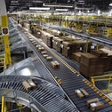 Packages pass through a scanner at an Amazon fulfillment center in Baltimore, August 2, 2017.