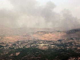 Smoke billows above the hills of Kfarchouba in the Shaba Farms sector after reports of clashes in the Lebanese-Israeli border area, July 27, 2020.