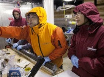 Prof. Yuki Morono and team in the shipboard refrigerator working on sediment samples
