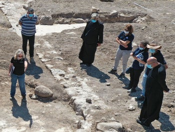 Head of the Greek Catholic Church, Youssef Matta, during his visit to the excavation site in Kfar Kama