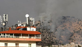 Smoke billows above the edges of southern Lebanon's Kfarchouba village reports of clashes in the Lebanese-Israeli border area, on July 27, 2020.