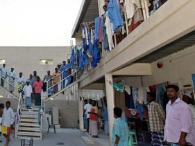 Exacerbated by crowded living conditions and poor healthcare access (here, a Dubai labor camp), migrant workers account for the majority of over 500,000 coronavirus cases reported in the Gulf
