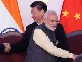 Indian Prime Minister Narendra Modi and Chinese President Xi Jinping shake hands with leaders at the BRICS summit in Goa, India. Oct. 16, 2016