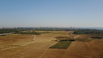 The battlefield of Arsuf looking south, with the city of Herzliya in the background,  taken by drone