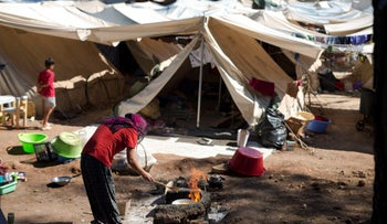 File photo: A Syrian woman fries eggs in front of her tent at Ritsona refugee camp north of Athens, Greece, July 14, 2016.