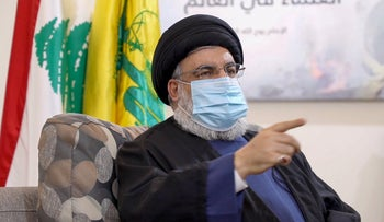 Hassan Nasrallah, the head of Lebanon's Shiite Muslim movement Hezbollah, ina video posted on Hezbollah's al-Manar TV website, on July 25, 2020.