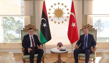 Erdogan and Fayez Sarraj, the head of Libya's internationally-recognized government, pose for photographs prior to their talks in Istanbul,on Saturday, July 25, 2020.