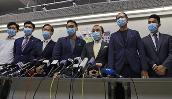 Pro-democracy Civic Party members attend a news conference after disqualifying for a September legislative election in Hong Kong, July 30, 2020.