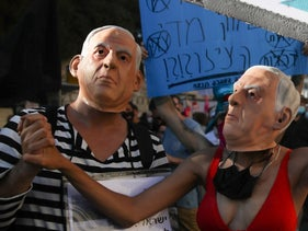 Protesters in Netanyahu masks at a demonstration in Jerusalem, July 24, 2020.