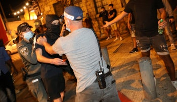 Israeli policemen confronting a member of the extremist far-right La Familia group in Jerusalem, July 30, 2020