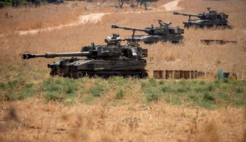 Israeli mobile artillery units sit in place near the border with Lebanon, July 28, 2020.