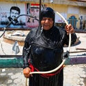 An Iraqi woman cools down with water from a hose in Tahrir Square in the capital Baghdad, on August 1, 2020,
