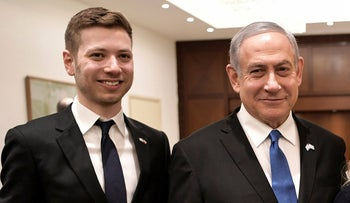 Prime Minister Benjamin Netanyahu and son Yair pose for a photo in Tel Aviv ahead of the World Holocaust Forum, January 23, 2020.