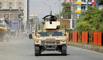 An Army vehicle patrols near the site of an attack on a jail compound in Jalalabad, Afghanistan, August 3, 2020.