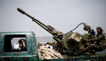 A Houthi fighter mans a machine gun mounted on a military truck during a gathering of Houthi loyalists on the outskirts of Sanaa, Yemen, July 8, 2020.