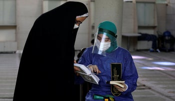 Worshippers wearing protective gear to help prevent the spread of the coronavirus attend a ceremony to pray during Arafat Day in the mosque of Tehran University, Iran, July 30, 2020.
