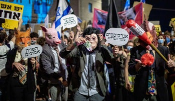 Protesters dressed up in costumes outside the prime minister's official residence in Jerusalem, August 1, 2020.