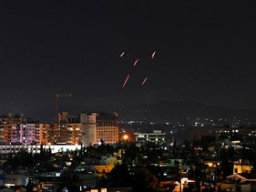 Syrian Air defenses respond to Israeli missiles allegedly striking targets south of the capital Damascus, on July 20, 2020.
