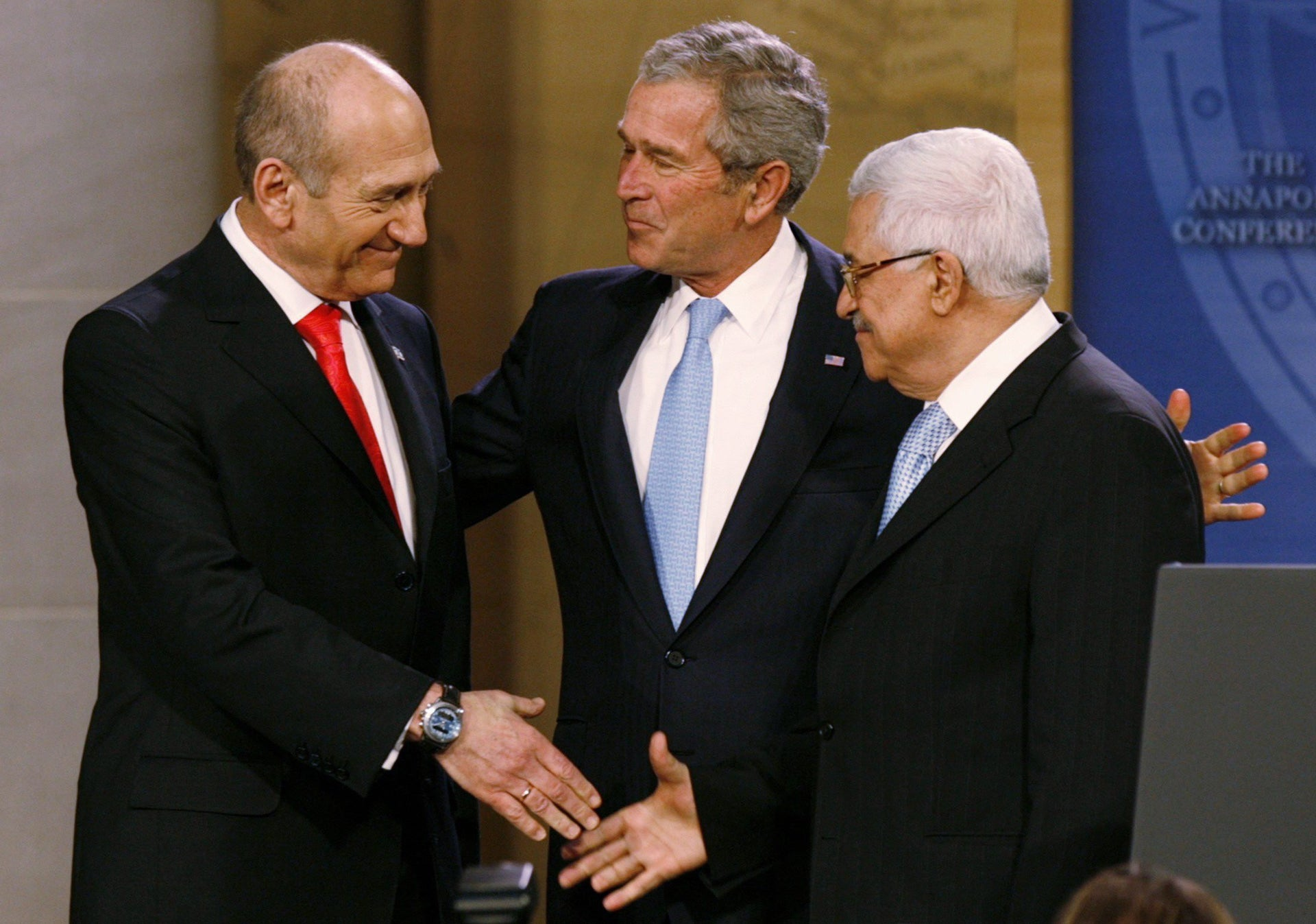 U.S. President George W. Bush standing Prime Minister Ehud Olmert and Palestinian President Mahmoud Abbas at the Israel-Palestinian Peace Conference at the U.S. Naval Academy in Annapolis, November 27, 2007.