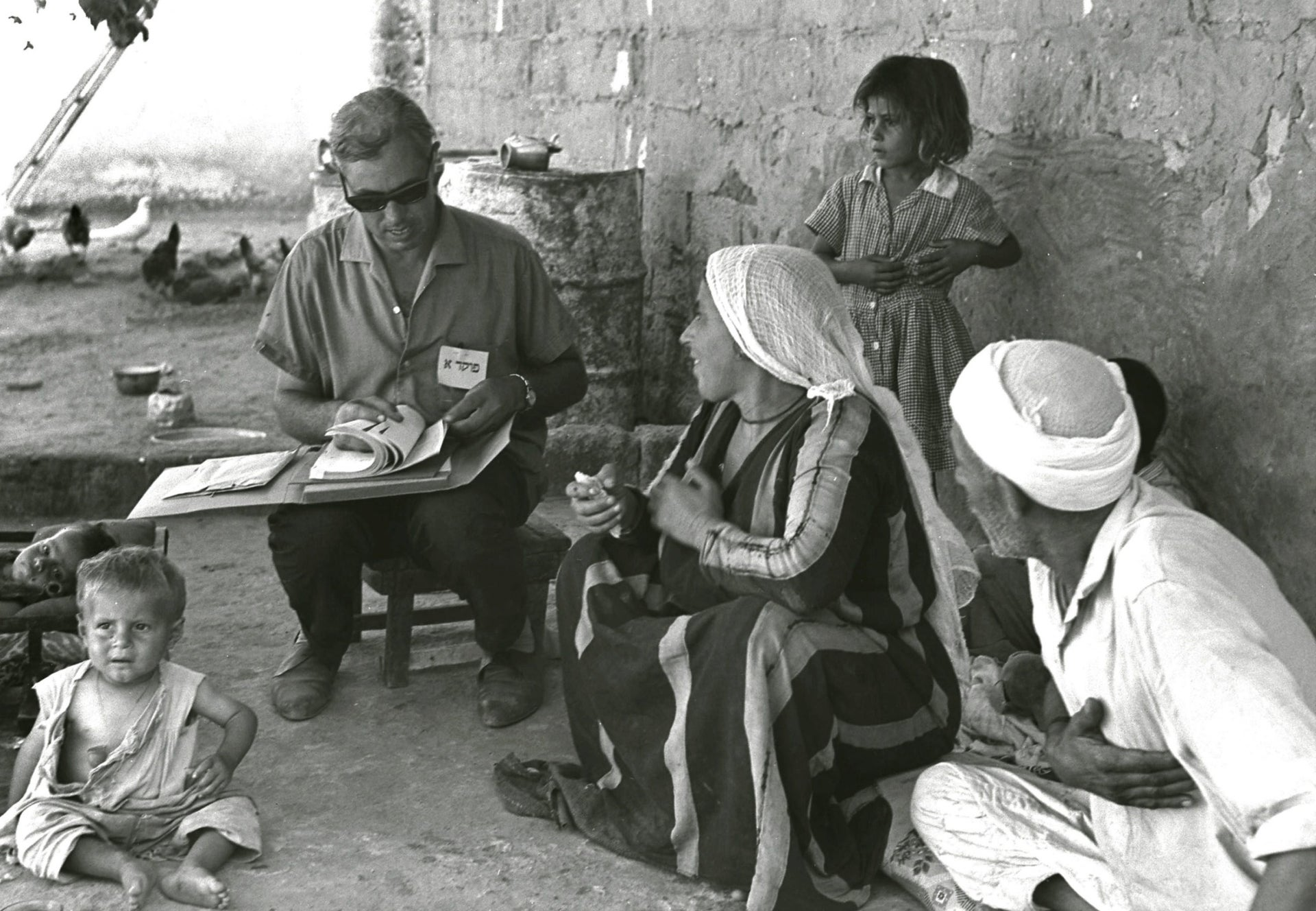 Israeli census taker Josef Levy interviewing a Palestinian family in their courtyard in Gaza City, three months after the Six-Day War, September 14, 1967.