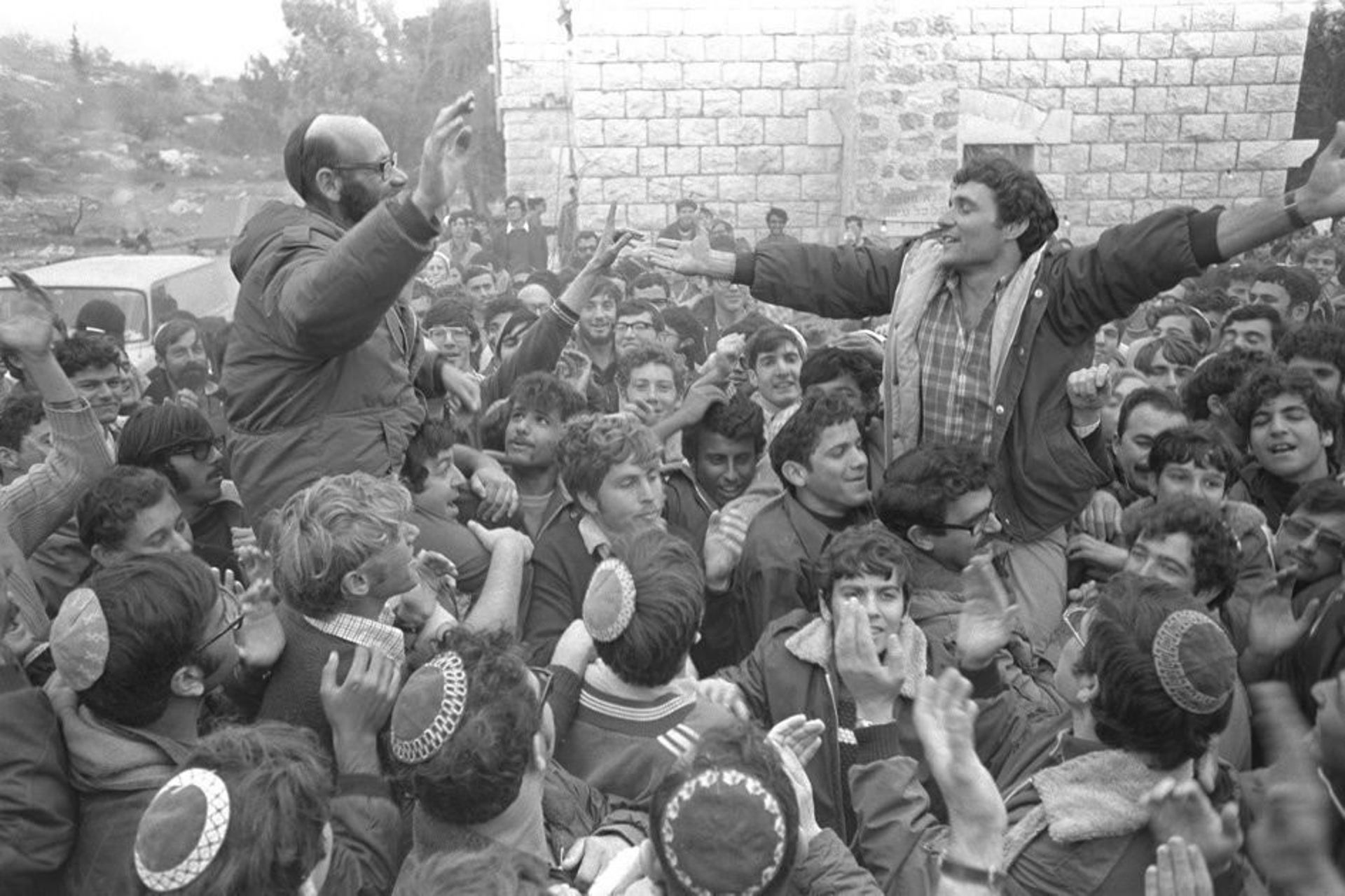 Rabbi Moshe Levinger, left, Hanan Porat and their followers celebrating the agreement with the left-wing Israeli government that settlers could stay in the West Bank, December 1975.