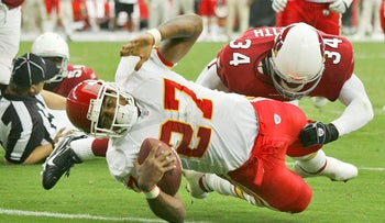 Kansas City Chiefs Larry Johnson (27) stretches across the goal line for a touchdown as Arizona Cardinals Robert Griffith defends during the second quarter of a football game at Cardinals Stadium in Glendale, Ariz., in this Oct. 8, 2006 file photo.