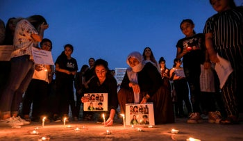 Iraqi Yazidis attend a vigil in the Sharya area, marking the sixth anniversary of the Islamic State attack on the Yazidi community in the northwestern Sinjar district, Iraq, August 3, 2020