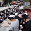 Religious Jews attend midday outdoor prayers in Uman city center prior to the annual Rosh Hashanah celebration, September 9, 2018