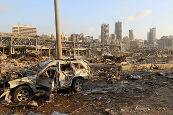 A damaged vehicle is seen at the site of an explosion in Beirut, August 4, 2020.