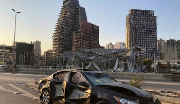 Damaged vehicle and buildings are pictured near the site of Tuesday's blast in Beirut's port area, Lebanon August 5, 2020