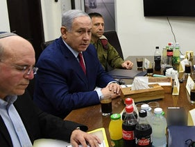 Meir Ben Shabbat, left close to the camera, and Yossi Cohen, right at the end of the table, at a security meeting with Prime Minister Netanyahu, second left.