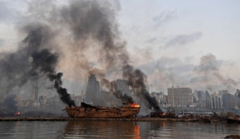 A ship in flames at the port of Beirut following the massive explosion, August 4, 2020.