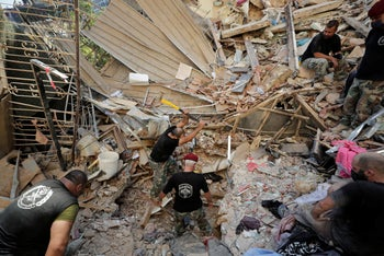 Lebanese soldiers search for survivors after a massive explosion in Beirut, Lebanon, Aug. 5, 2020.