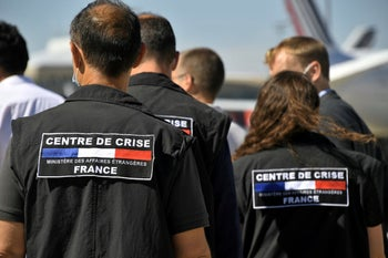 Search and rescue experts from France board an Airbus A330 as France sends aid to Beirut, August 5, 2020.