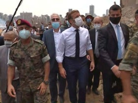 French President Emmmanuel Macron inspects the damages at the port of Lebanon's capital Beirut, on August 6, 2020.