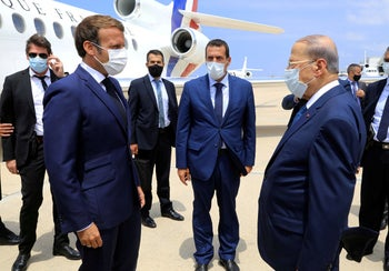 Lebanon's President Michel Aoun welcomes French President Emmanuel Macron upon his arrival at the airport in Beirut, Lebanon, on August 6, 2020.