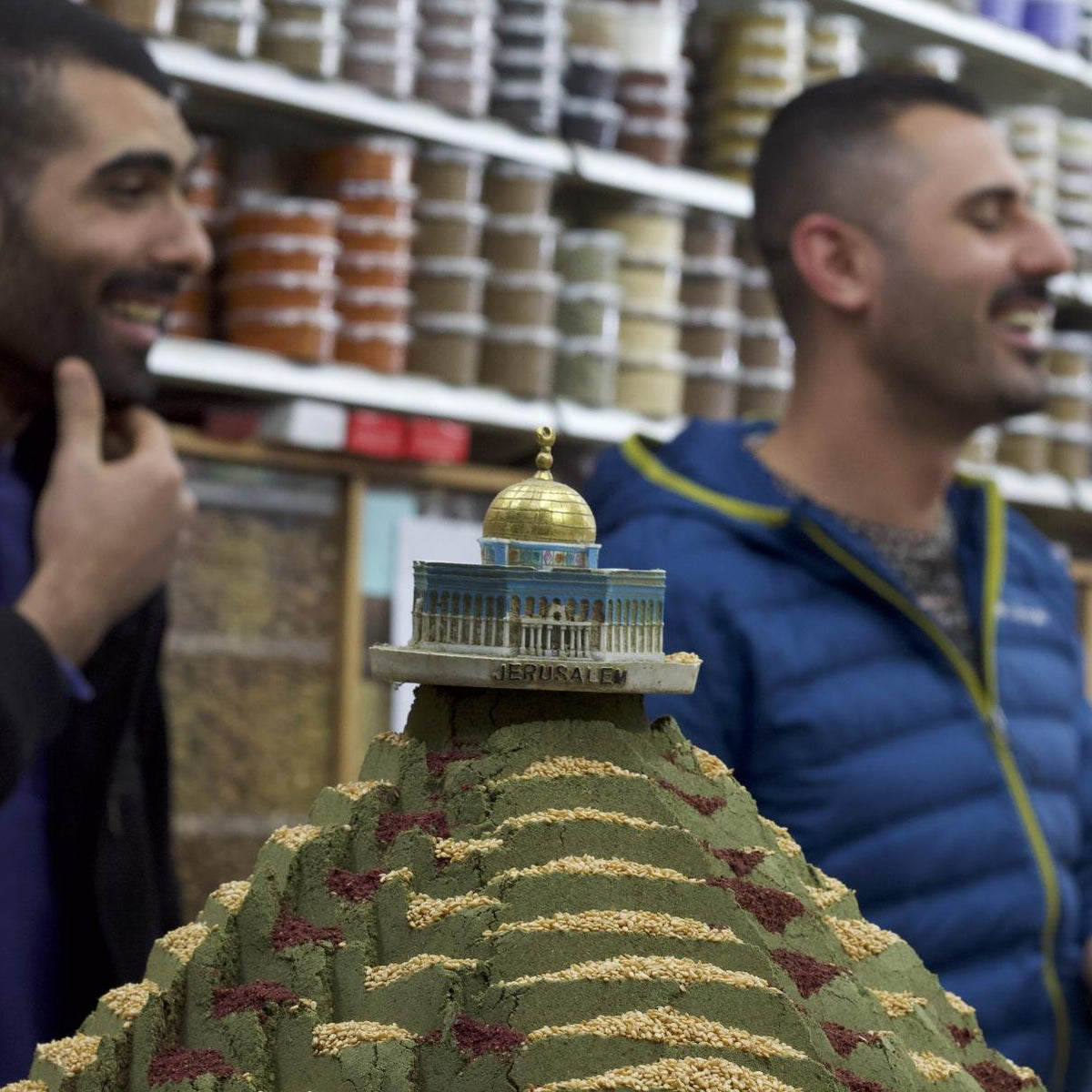 JPEG Sheikh Qassem and his brother behind a za'atar pyramid and a miniature of the Dome of the Rock. Credit_ Yasmin Zaher.jpg