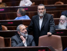 Shas head Arye Dery and United Torah Judaism co-chair Moshe Gafni in the Knesset, May 20, 2020.