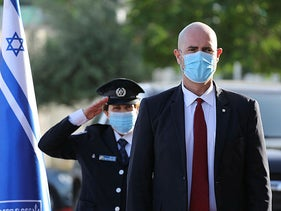 Public Security Minister Amir Ohana, wearing a mask.