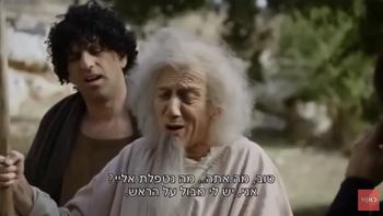 Moni Moshonov playing Noah in the satirical show 'The Jews Are Coming'