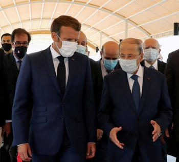 Lebanon's President Michel Aoun welcomes French President Emmanuel Macron upon his arrival at the airport in Beirut, August 6, 2020