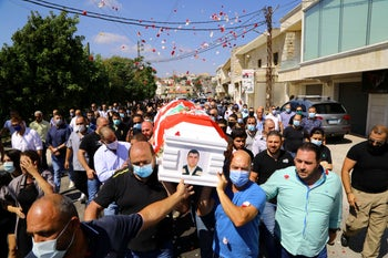 Relatives and friends carry the coffin of Corporal Gerges Deabes, who died as the result of Tuesday's blast in Beirut's port area, in Klayaa, Lebanon August 6, 2020.