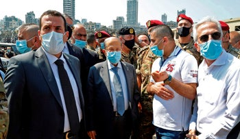 Lebanon's President Michel Aoun wears a protective face mask as he visits the site of a massive explosion in Beirut, August 5, 2020.