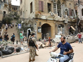 Residets inspect the damage along Gouraud street in the Gemayzeh neighbourhood of Beirut to clear debris on August 6, 2020