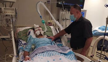 22-year-old Abd al-Rahman Jabarah and his father, Hosni, at the Sheba medical center where he is receiving treatment, August 7, 2020.
