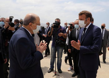 Lebanon's President Michel Aoun welcomes French President Emmanuel Macron upon his arrival at the airport in Beirut, Lebanon August 6, 2020