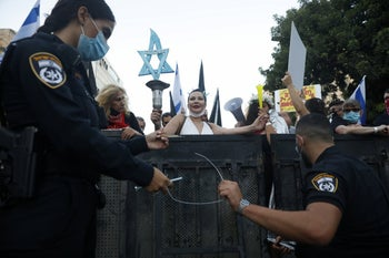 Police at the scene of an anti-Netanyahu protest in Jerusalem on August 8, 2020.