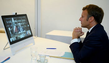 French President Emmanuel Macron listens during a video-conference on the situation in Lebanon from Fort de Bregançon, southern France, August 9, 2020.
